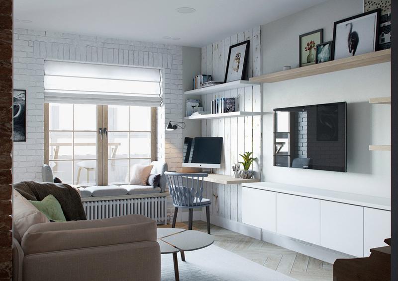 mini appartamento in azzurro, bianco e legno | il soggiorno con angolo relax e piccolo home office