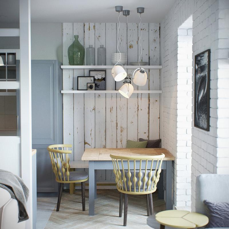 mini appartamento in azzurro, bianco e legno | la piccola zona pranzo ad angolo in cucina