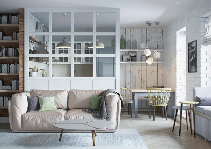 mini appartamento in azzurro, bianco e legno | vista del soggiorno e della parete vetrata divisoria della cucina