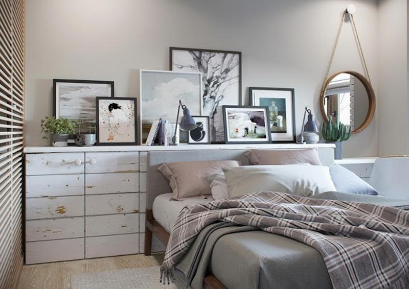 mini appartamento in azzurro, bianco e legno | la camera da letto con mensola e vano contenitore dietro la testiera